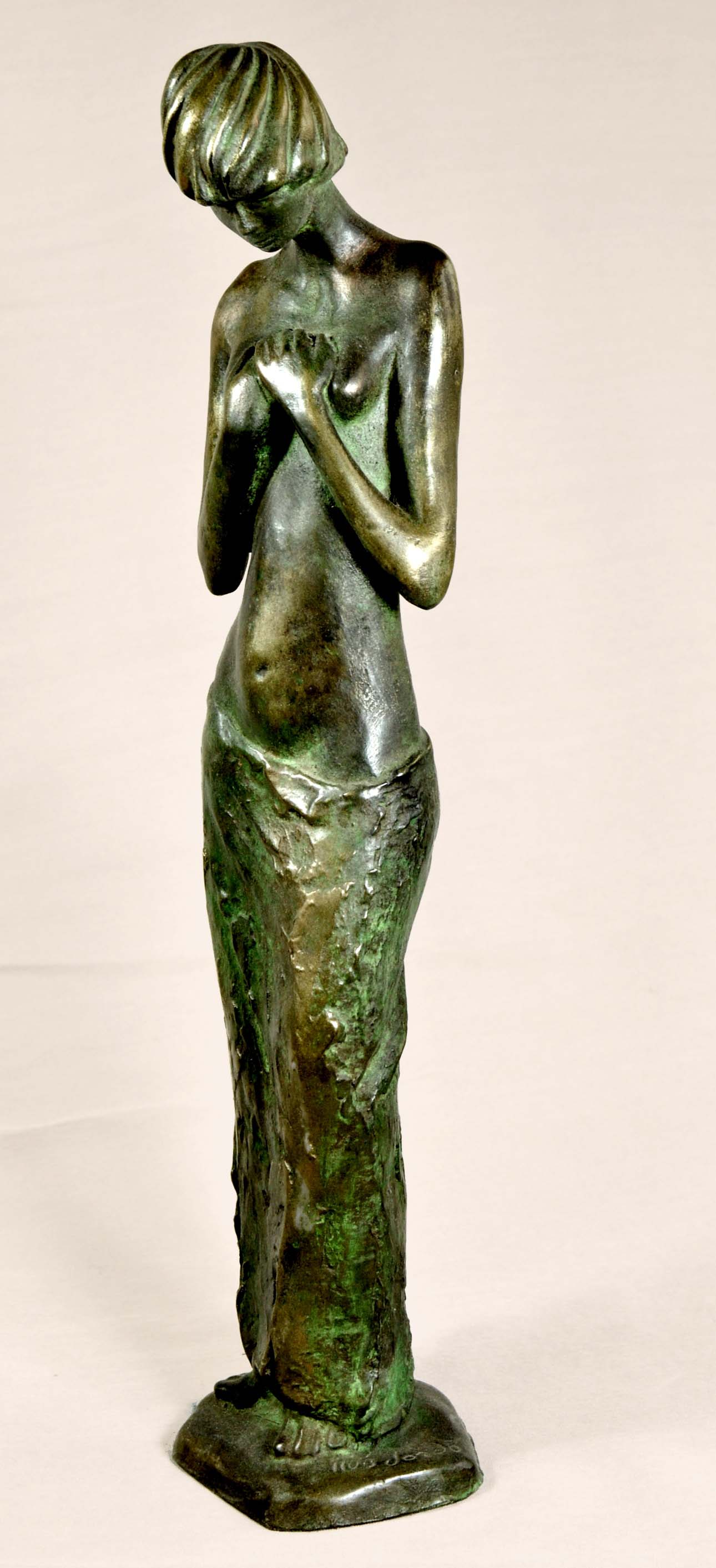 Sculpture of a girl with nude torso