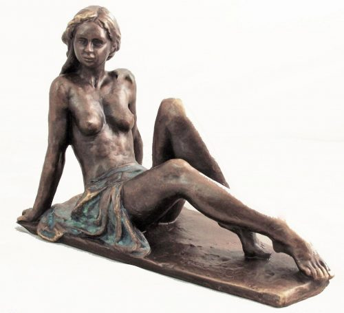 Sculpture of nude woman seated on a plinth.