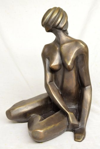 Modern figurative statue of a nude woman