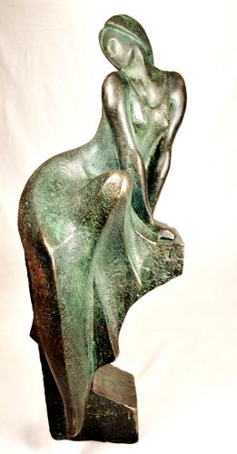Rather big size bronze sculpture, featuring a woman seated opna pedestal, clad with green patina dress