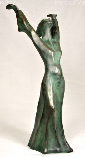 sculpture of woman with raised arms