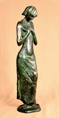 Delicate sculpture of a girl covering her breasts with  her hands