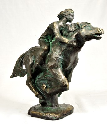 Statuette of a boy riding a horse in full gallop