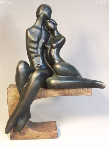 Nude couple seated on a pedestal