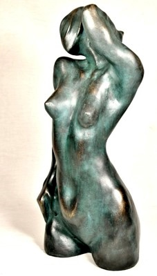 bronze sculpture of naked woman torso with green oxide patina