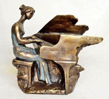 Woman playing at her piano