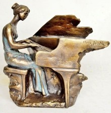 Sculpture  woman playing at a grand piano