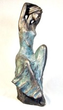 Cold cast bronze sculpture, woman seated on a pedestal