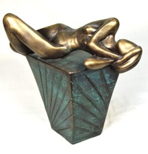 Sculpture young woman lying on a plinth
