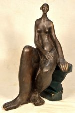 Modern style bronze sculpture of a seated naked woman